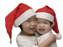 Beautiful Christmas Sisters. Two little girls who celebrate christmas day with white background Royalty Free Stock Photography