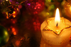 Beautiful Christmas Star candle with holiday decoration Royalty Free Stock Image