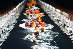 Beautiful Christmas table decorations with snow. Nice serve Stock Images