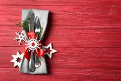 Beautiful Christmas table setting on background. Beautiful Christmas table setting on red background Royalty Free Stock Photo
