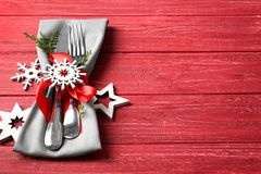 Beautiful Christmas table setting. On red background Stock Photos