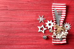 Beautiful Christmas table setting. On red background Royalty Free Stock Photography