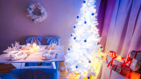 Beautiful Christmas table setting with blue and white decoration Royalty Free Stock Images