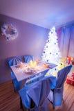 Beautiful Christmas table setting with Christmas tree Royalty Free Stock Photography