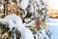 Beautiful Christmas toy on a snow-covered tree in winter Royalty Free Stock Images