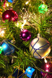 A beautiful Christmas tree. Beautiful New Year s decorations in different colors on the Christmas trees, photography Stock Photos