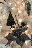 Beautiful Christmas tree with black ornaments Royalty Free Stock Photos