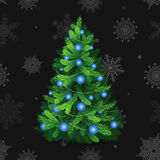 Beautiful christmas tree with blue balls. Christmas tree on black background with snowflakes Stock Photos