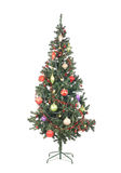 A beautiful Christmas tree covered with toys and balls Royalty Free Stock Photos
