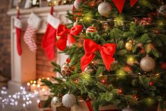 Beautiful Christmas tree with decor and gift boxes. Indoors stock images