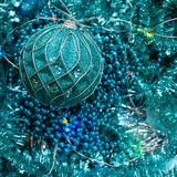 Flatlay of New Year or Christmas decorations of turquoise color: tinsel, balls, garlands, stars royalty free stock photos