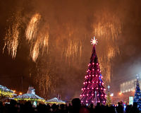 Beautiful Christmas tree and fireworks Royalty Free Stock Photography
