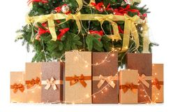 Beautiful Christmas tree with gifts. On white background Stock Image