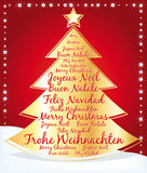 Beautiful christmas tree with greetings in several languages. Stock Photo