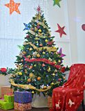 Beautiful Christmas tree with presents around it stock photo