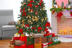 Beautiful Christmas tree with presents. In living room Royalty Free Stock Images
