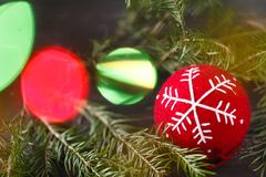 Beuatiful Christmas tree rich decorated with toys stands over pr Stock Photo