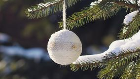 Beautiful Christmas tree with handmade toy in a park stock video footage