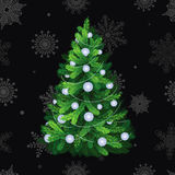 Beautiful christmas tree with white balls. Christmas tree on black background with snowflakes Stock Image