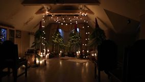 Beautiful christmas winter wedding arch at engagement decor interior with candles, birch logs, bulb garlands and fir stock footage