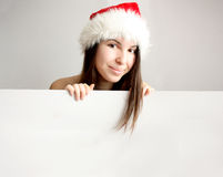 Beautiful Christmas woman behind a blank sign Stock Photography