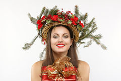 Beautiful christmas woman with gift in hand Royalty Free Stock Image