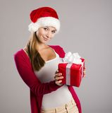 Beautiful christmas woman with gift Stock Photos