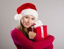 Beautiful christmas woman with gift stock photography