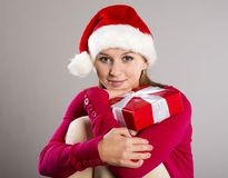 Beautiful christmas woman with gift Royalty Free Stock Photography
