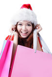 Beautiful Christmas woman happy take shopping bag Stock Photo