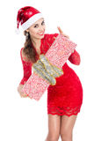 Beautiful christmas woman is holding gift Stock Image