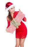 Beautiful christmas woman is holding gift Stock Image