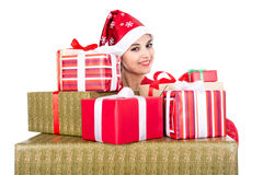 Beautiful christmas woman is holding gift in studio Stock Photos