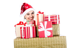 Beautiful christmas woman is holding gift in studio Stock Images