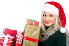 Beautiful christmas woman is holding gift in studio. Isolated Stock Image