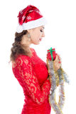 Beautiful christmas woman is holding red gift in studio. Stock Photography