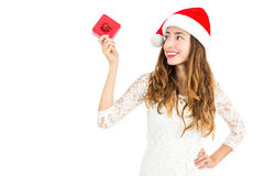 Beautiful christmas woman looking to gift Royalty Free Stock Photos