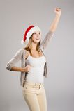 Beautiful christmas woman. Portrait of attractive woman isolated on gray, studio shot in christmas hat Stock Photography