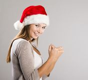 Beautiful christmas woman. Portrait of attractive woman isolated on gray, studio shot in christmas hat Royalty Free Stock Image