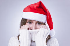 Beautiful Christmas woman with santa hat Stock Photo