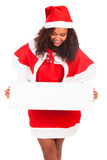 Beautiful christmas woman in santa hat with blank white board Stock Photos