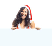 Beautiful christmas woman in santa hat holding empty Royalty Free Stock Photos