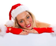 Beautiful christmas woman in santa hat Stock Images