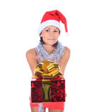 Beautiful christmas woman in santa hat holding gift Stock Images