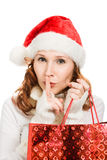 Beautiful Christmas woman showing silence gesture Royalty Free Stock Images