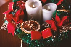 Beautiful Christmas wreath with candles on the table stock photos
