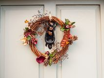 Beautiful christmas wreath on front of door hanging close up. Essex; england; uk Stock Image