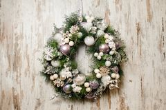 Beautiful Christmas wreath made of fir tree and decorated. With glass balls, toys and plants Stock Image