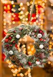 Beautiful Christmas wreath in woman hands. Preparation for holidays concept. Flower shop is a master work of a Royalty Free Stock Photography