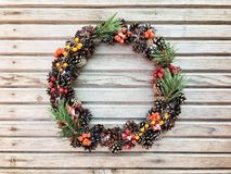 Beautiful wreath on the wooden background Royalty Free Stock Photo